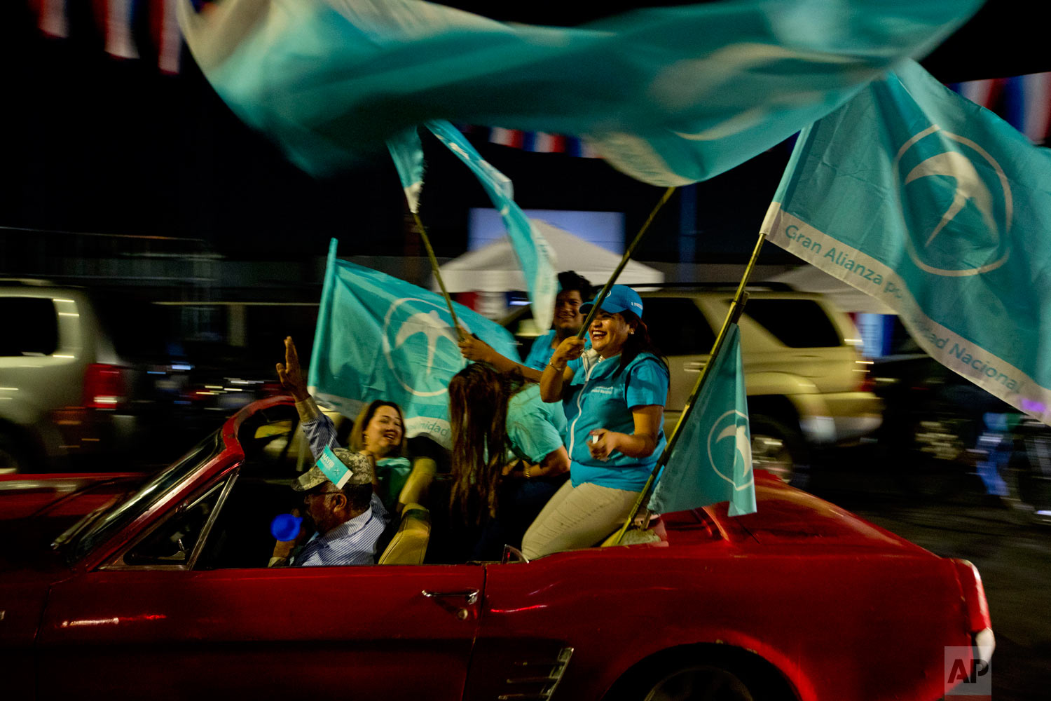 Supporters of presidential frontrunner Nayib Bukele, of the Grand National Alliance for Unity, GANA, rally in San Salvador, El Salvador, Jan. 30, 2019. Bukele won the election on Feb. 3, breaking the three-decade hold on power of the country's two dominant parties. (AP Photo/Moises Castillo)