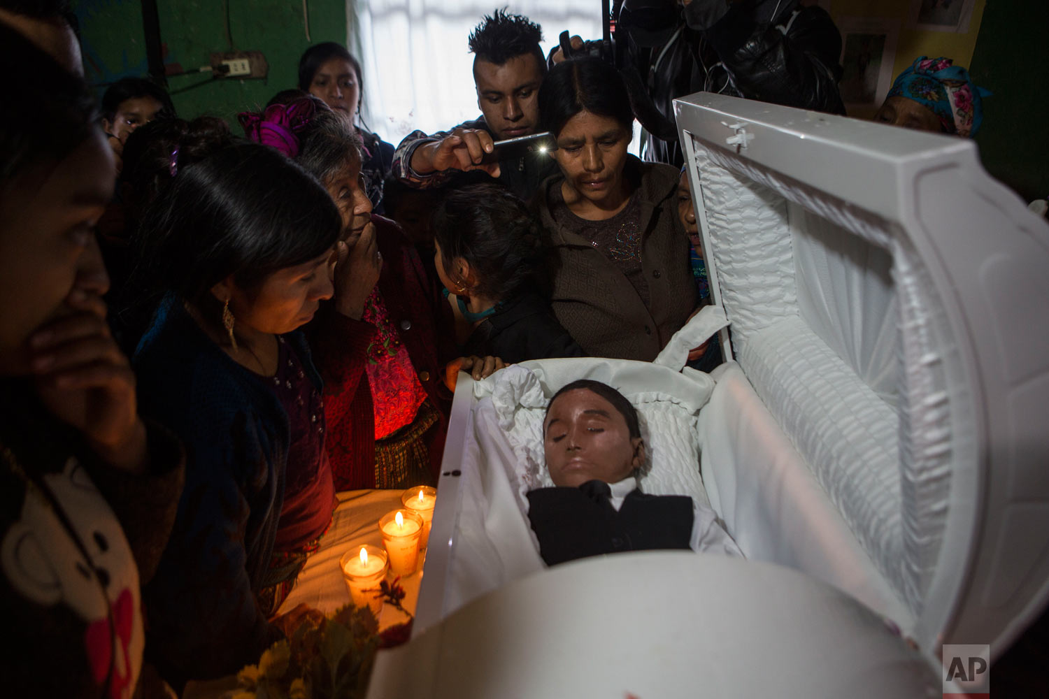 Family members pay their last respects to Felipe Gomez Alonzo, an 8-year-old migrant boy who died in U.S. custody at a New Mexico hospital on Christmas Eve, in Yalambojoch, Guatemala, Jan. 26, 2019. Felipe and his father were apprehended by the U.S. Border Patrol in mid-December. (AP Photo/Oliver de Ros)