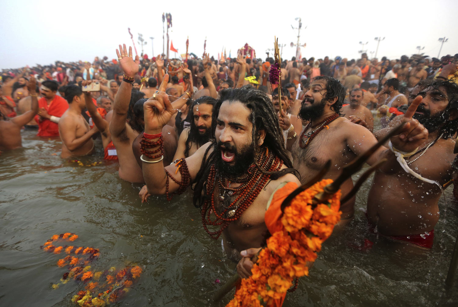 Naga Sadhus, naked Hindu holy men, take dips at Sangam, the confluence of three sacred rivers - the Yamuna, the Ganges and the mythical Saraswati - on Mauni Amavsya or the new moon day, the most auspicious day during the Kumbh Mela in Prayagraj, Uttar Pradesh state, India, on Monday, Feb. 4, 2019. The Kumbh Mela, or the Pitcher Festival, is a series of ritual baths by sadhus and other pilgrims that dates back to at least medieval times. Worshippers bathe in the river believing it cleanses them of their sins and ends their process of reincarnation. The event, which UNESCO added to its list of intangible human heritage in 2017, is the largest congregation of pilgrims on earth. Some 150 million people are expected to attend this year's Kumbh, which runs through early March. (AP Photo/Channi Anand)