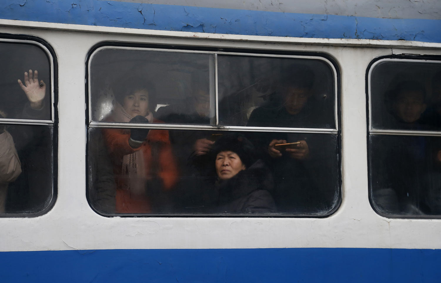 Passengers ride on a crowded tram in downtown Pyongyang, North Korea, Sunday, Feb. 3, 2019. (AP Photo/Dita Alangkara)