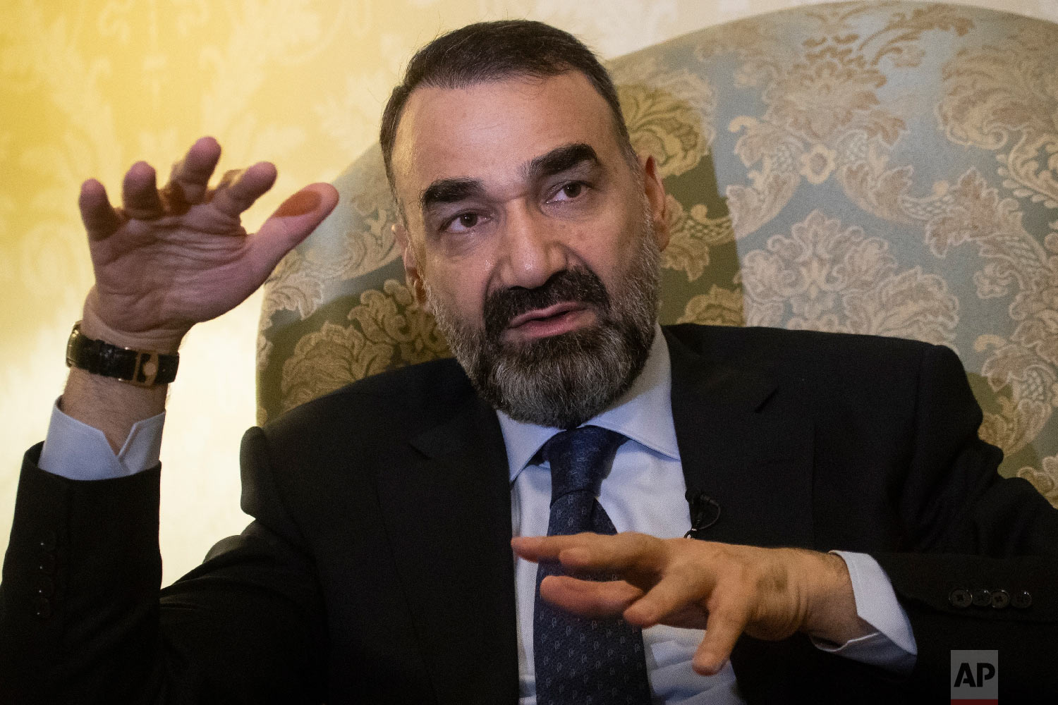 Ata Mohammad Noor, a former warlord who fought Soviet troops and served as governor of the northern Balkh province from 2004-2018, speaks during an interview with The Associated Press in Moscow, Russia on Feb. 8, 2019. (AP Photo/Pavel Golovkin)