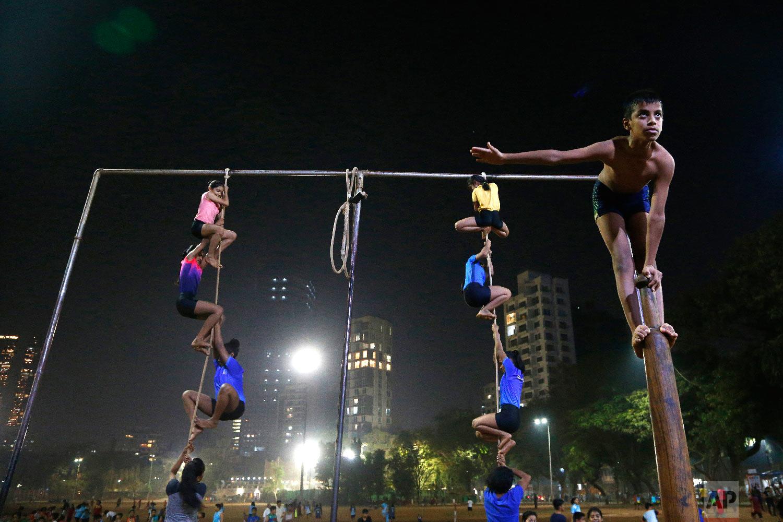 Players perform on a mallakhamb pole and rope at the Shree Samartha Vyayam Mandir at Shivaji Park in Mumbai, India, on Feb. 4, 2019. (AP Photo/Rafiq Maqbool)