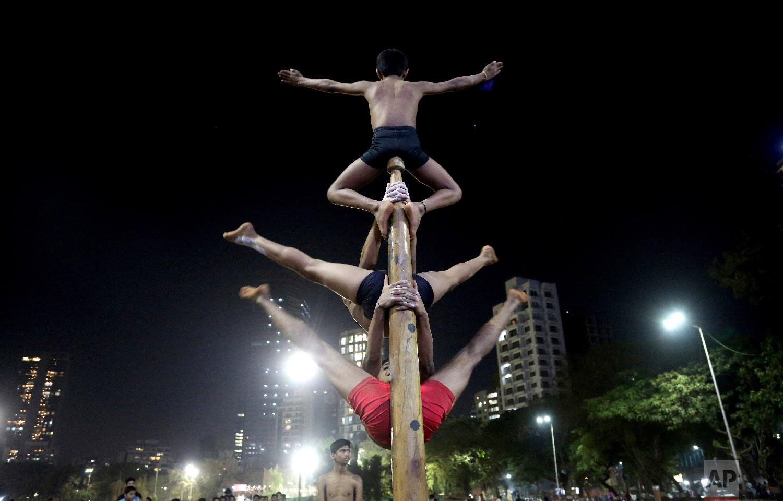 Players perform on a mallakhamb pole at the Shree Samartha Vyayam Mandir at Shivaji Park on Feb. 6, 2019, in Mumbai, India. (AP Photo/Rafiq Maqbool)