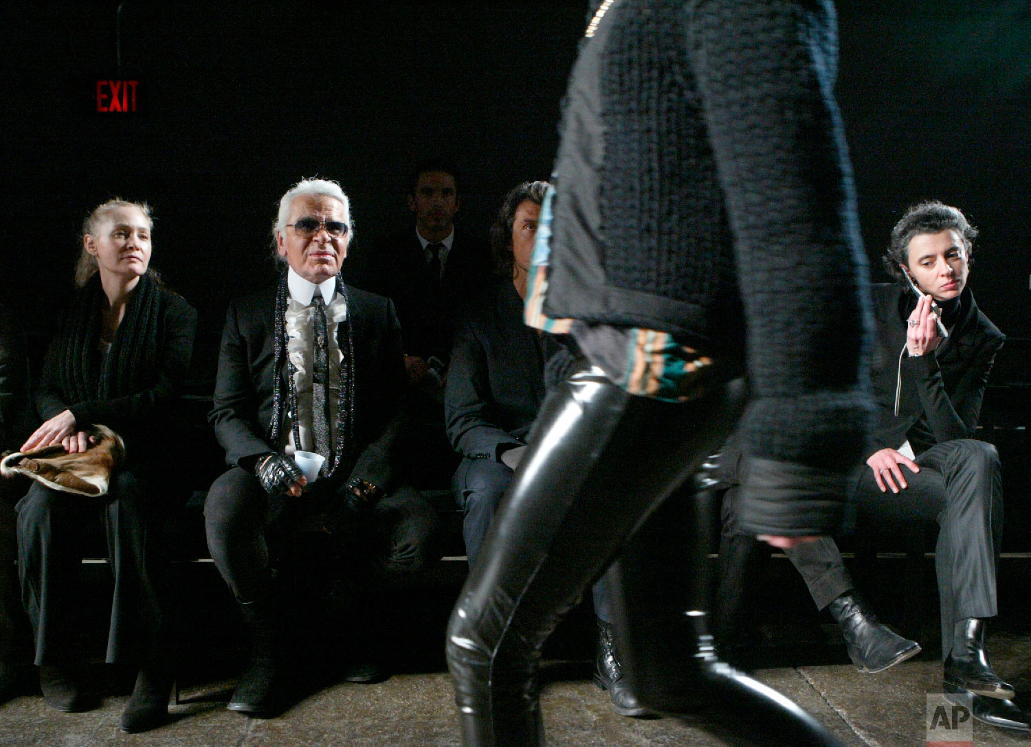 Karl Lagerfeld, second from left, and his creative director Melanie Ward, left, watch a rehearsal before the presentation of his fall 2006 collection on the last day of Fashion Week in New York, Feb. 10, 2006, (AP Photo/Diane Bondareff)