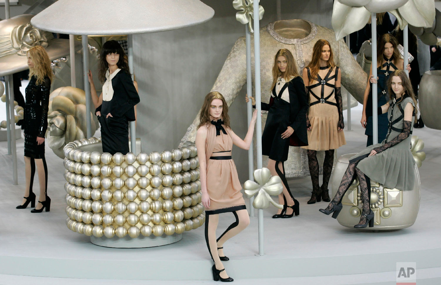 Models wear creations by German fashion designer Karl Lagerfeld for Chanel's fall-winter 2008-2009 ready to wear collection presented in Paris, Feb. 29, 2008. (AP Photo/Christophe Ena)