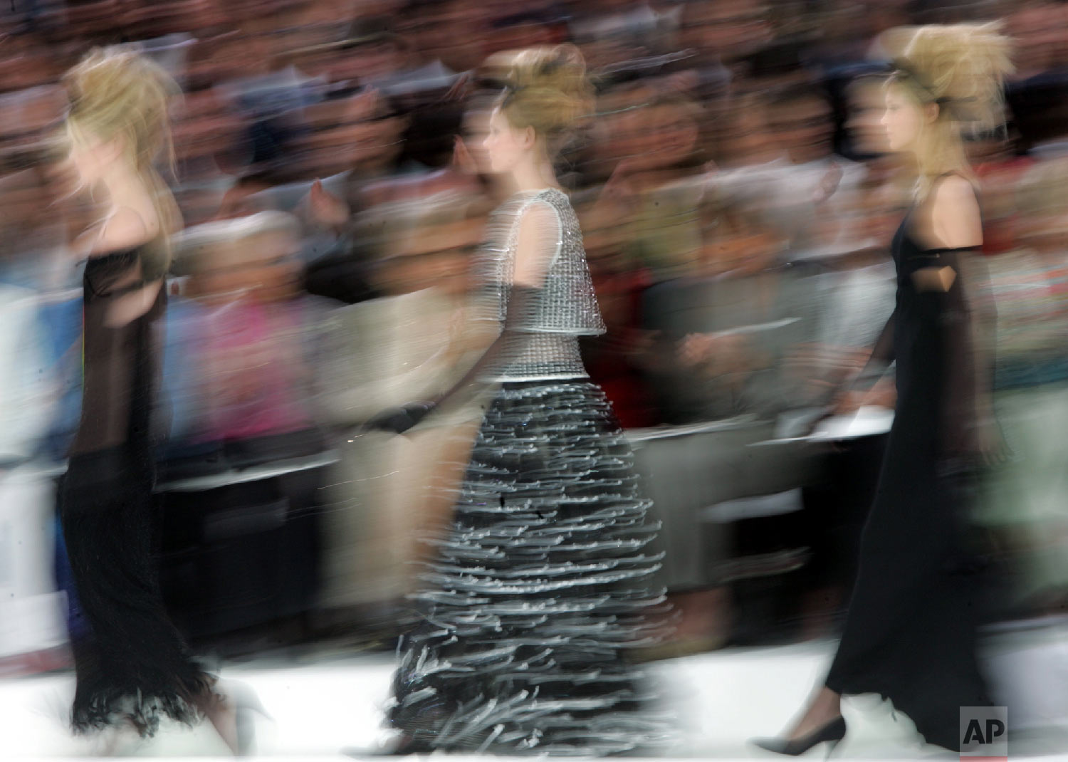 Models present creations for Chanel's fall-winter 2005-2006 haute-couture collection designed by German fashion designer Karl Lagerfeld and presented in Paris, July 7, 2005. (AP Photo/Jerome Delay)