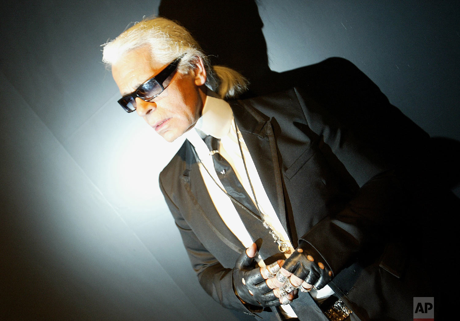 German Fashion designer Karl Lagerfeld is seen backstage during the presentation of Chanel's spring-summer 2005 haute couture fashion collection presented in Paris on Jan. 25, 2005. (AP Photo/Jerome Delay)