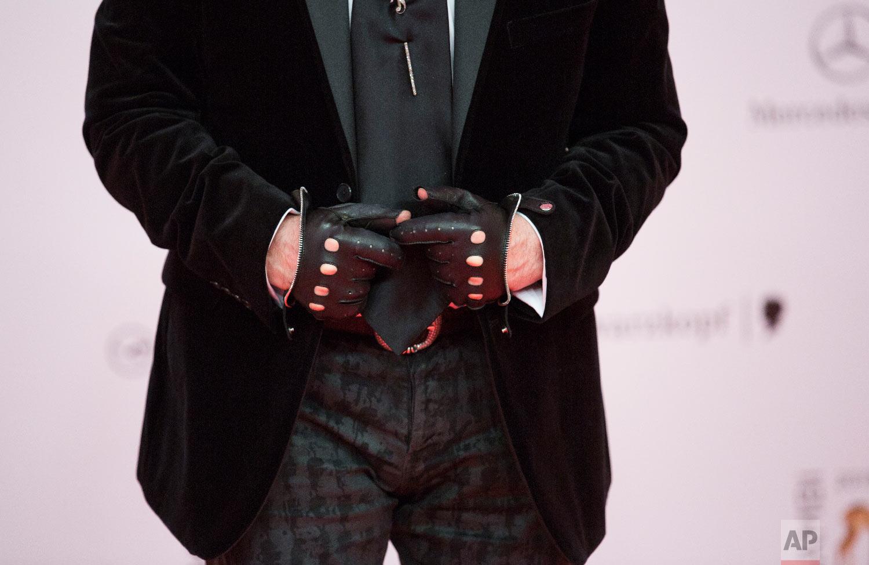 Karl Lagerfeld arrives for the Bambi 2013 media awards in Berlin, Germany, Nov. 14, 2013. (AP Photo/Gero Breloer)