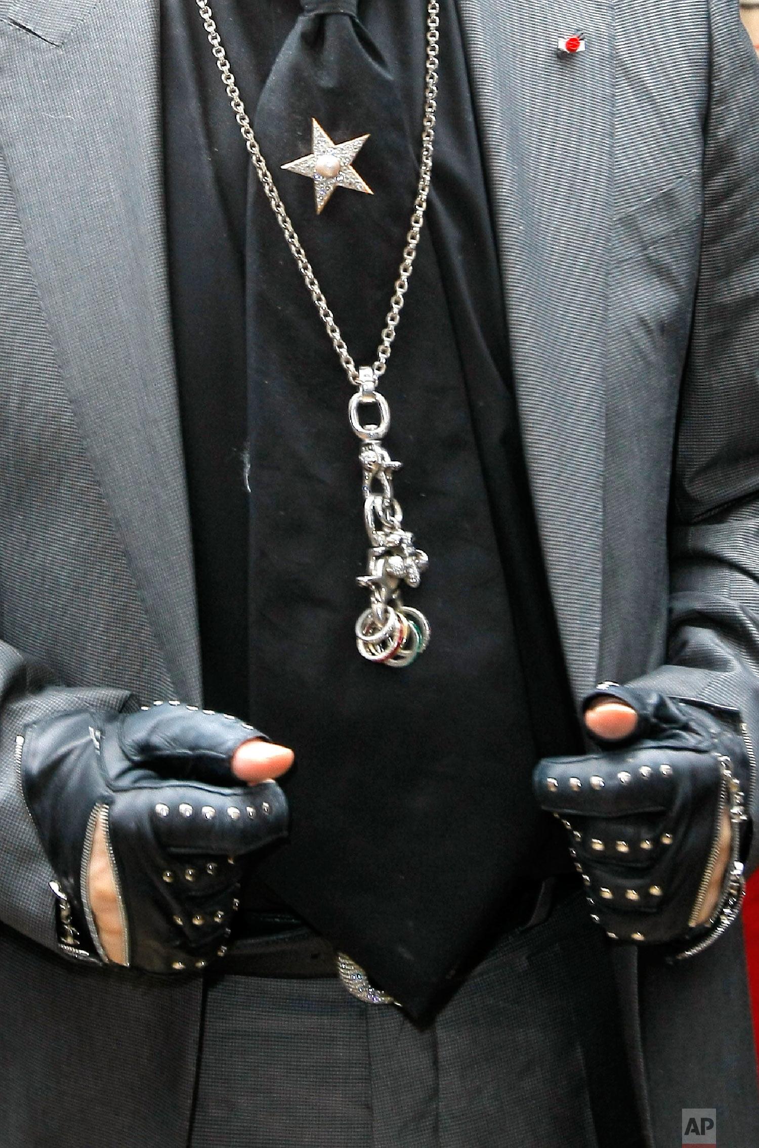 Lagerfeld's arrives to promote a commercial April, 28, 2011 in Paris. (AP Photo/Jacques Brinon)