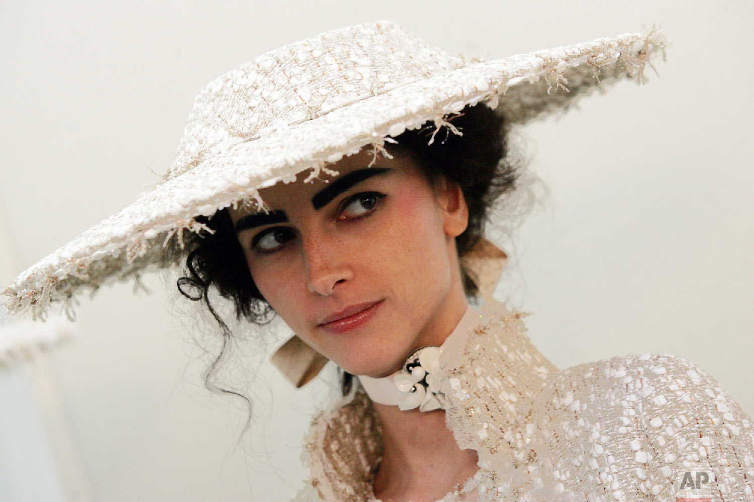 A model waits backstage before modeling for Chanel's spring-summer 2005 haute couture fashion collection designed by German fashion designer Karl Lagerfeld, presented in Paris, Jan. 25, 2005 in Paris. (AP Photo/Jerome Delay)