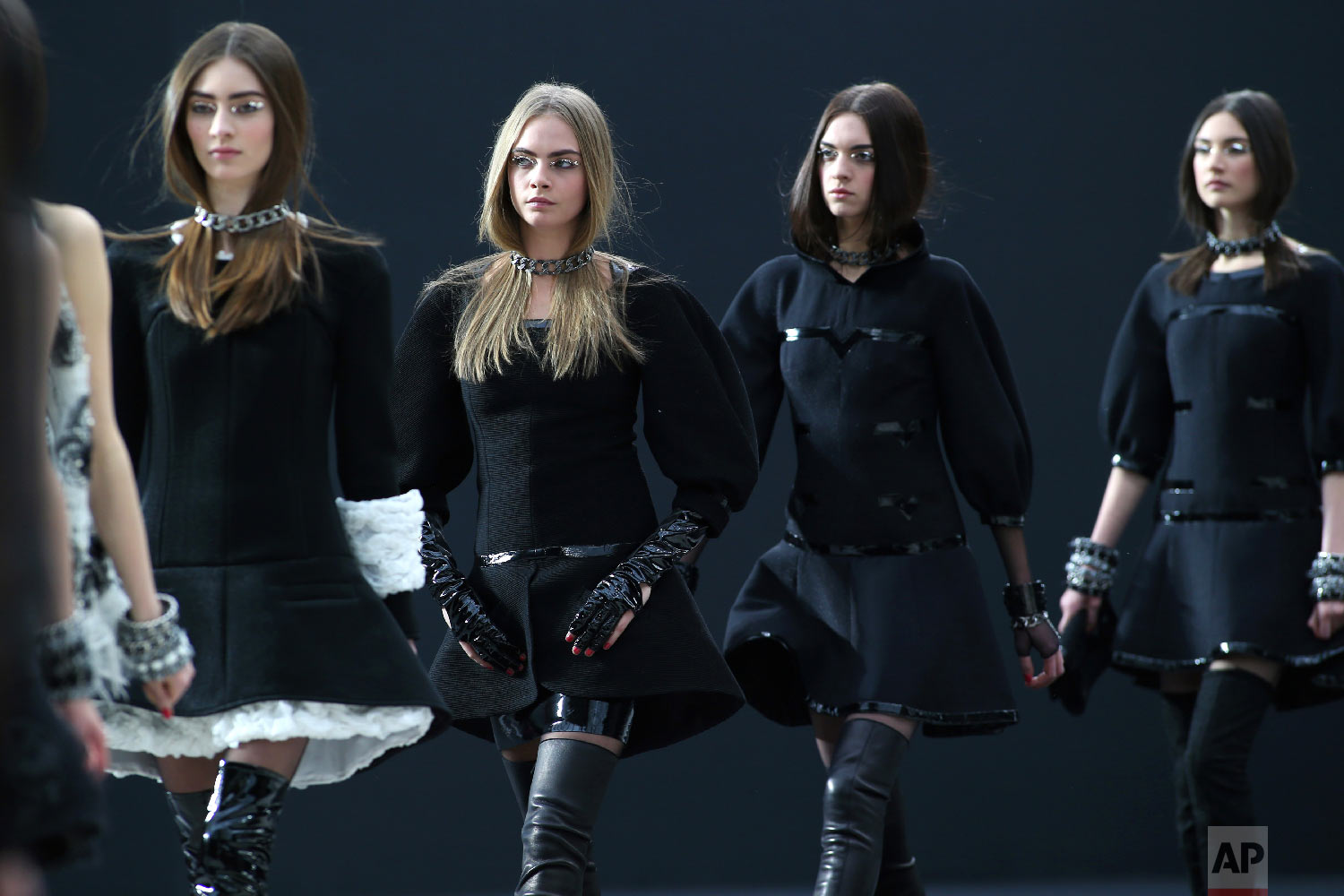 Models wear creations by German fashion designer Karl Lagerfeld for Chanel's Fall/Winter 2013-2014 ready to wear collection, in Paris, March, 5, 2013. (AP Photo/Thibault Camus)