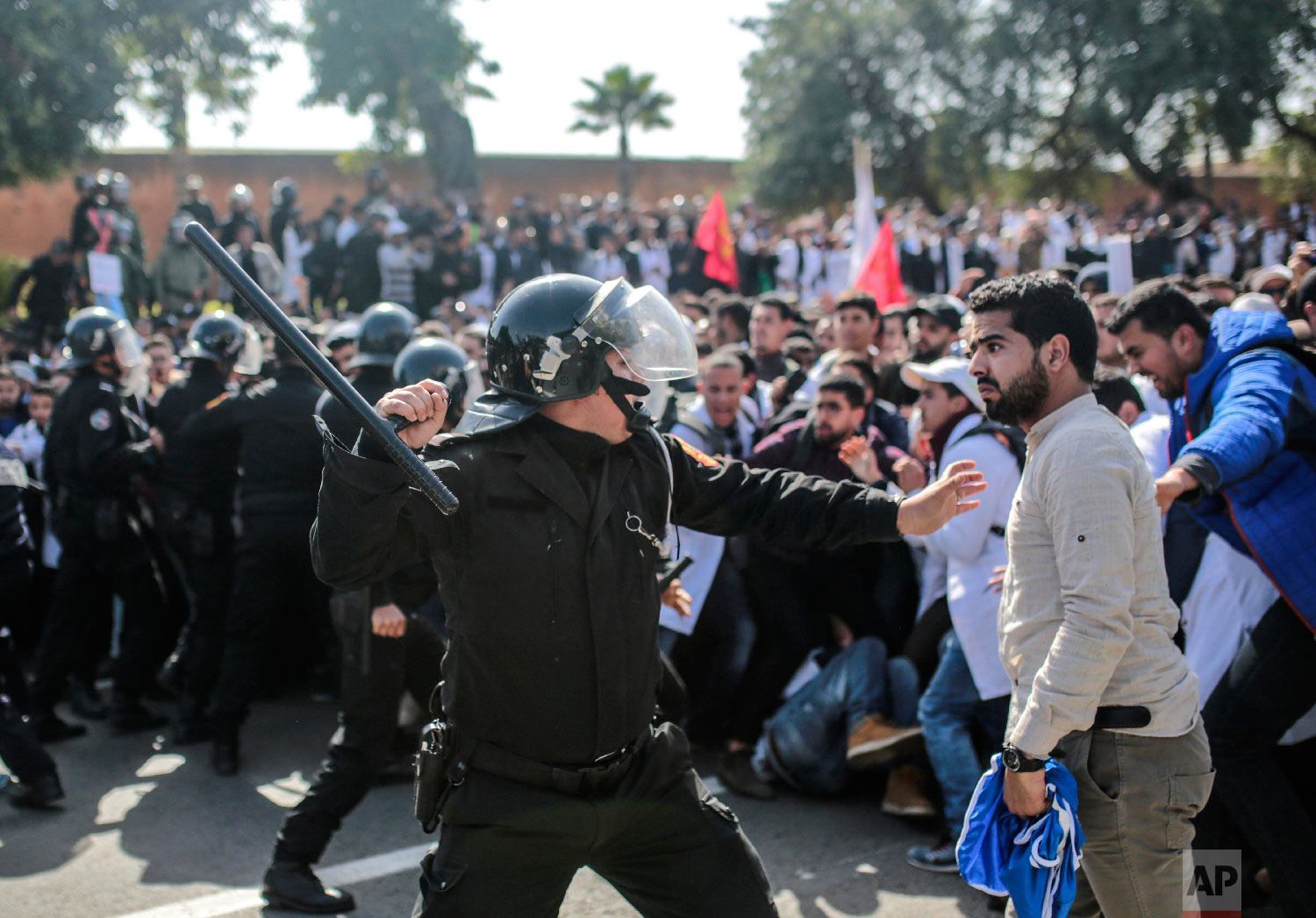 Security forces charge at protesting teachers during a demonstration in Rabat, Morocco, Feb. 20, 2019. (AP Photo/Mosa'ab Elshamy)
