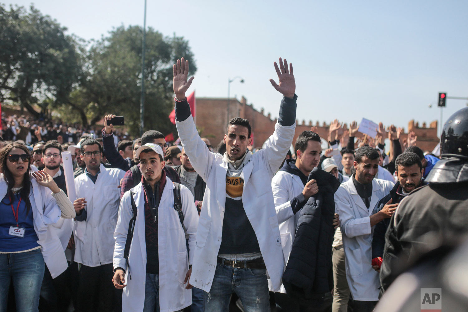 Teachers chant slogans and gesture during a demonstration in Rabat, Morocco, Feb. 20, 2019. (AP Photo/Mosa'ab Elshamy)