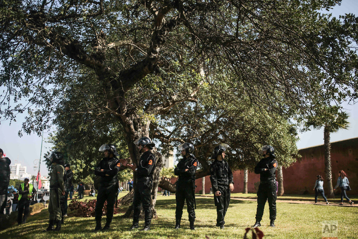 Security forces stand guard as they attempt to disperse a protest in Rabat, Morocco, Feb. 20, 2019. (AP Photo/Mosa'ab Elshamy)