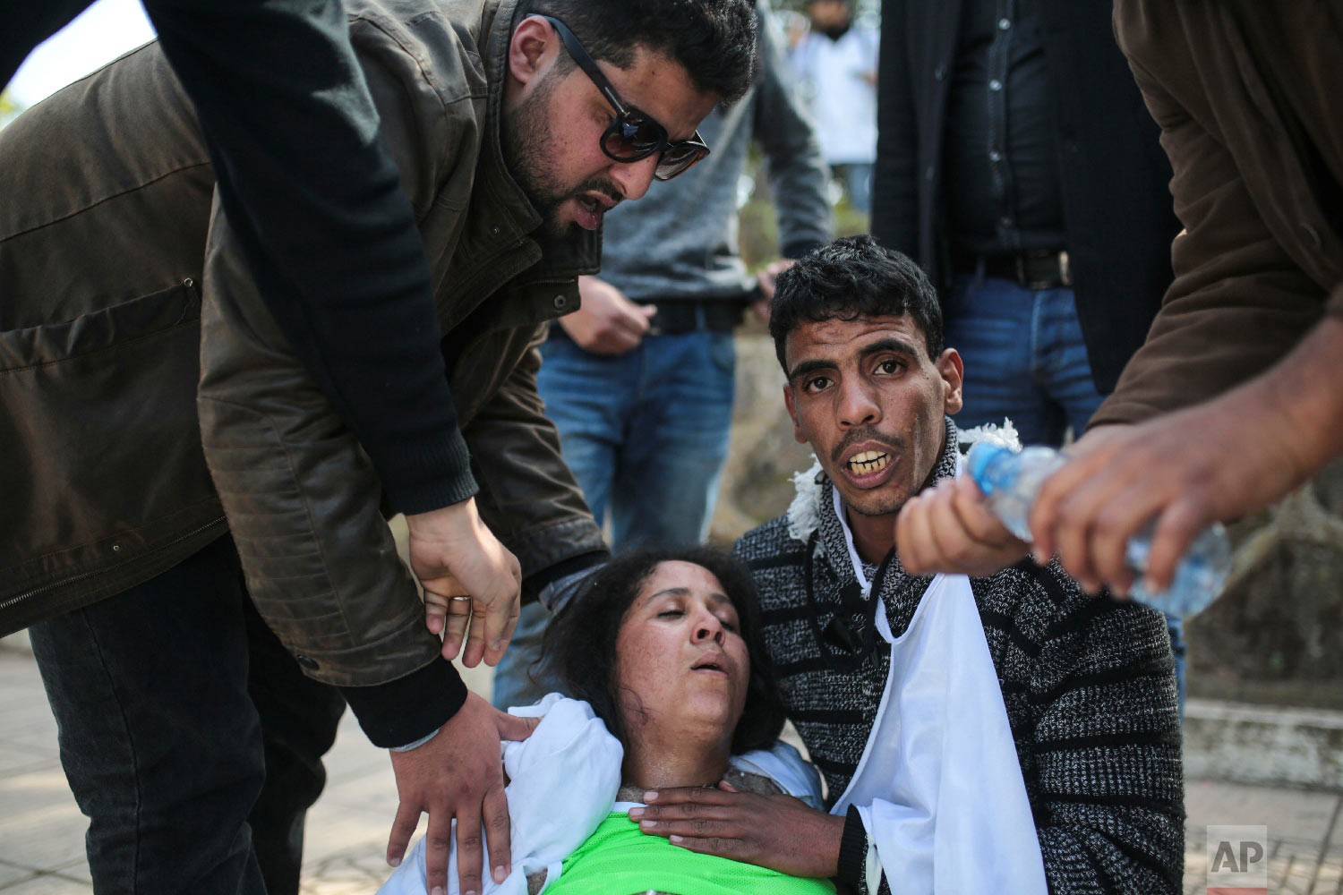 An injured protesting teacher is tended to by colleagues in Rabat, Morocco, Feb. 20, 2019. (AP Photo/Mosa'ab Elshamy)