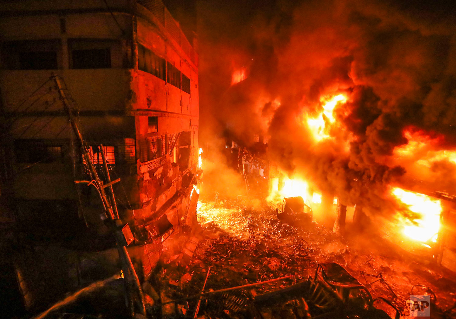 Flames rise from a fire in a densely packed shopping area in Dhaka, Bangladesh, Thursday, Feb. 21, 2019. (AP Photo/Zabed Hasnain Chowdhury)