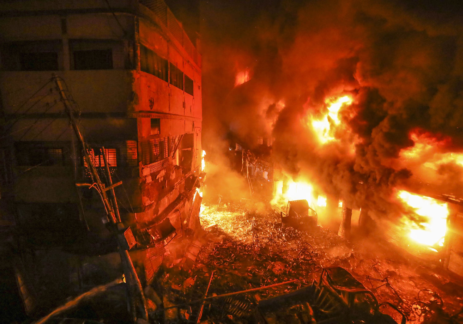 Flames rise from a densely packed shopping area in Dhaka, Bangladesh, Thursday, Feb. 21, 2019. The devastating fire raced through several buildings in an old part of Bangladesh's capital, killing scores of people. (AP Photo/Zabed Hasnain Chowdhury)
