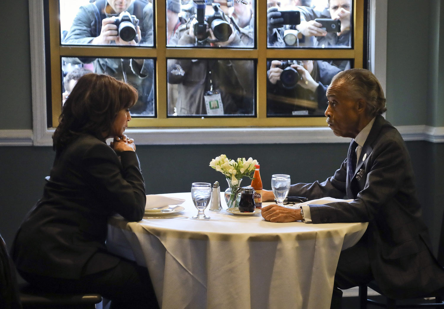 Democratic presidential candidate Sen. Kamala Harris, D-Calif., left, meets with civil rights leader Rev. Al Sharpton, president of the National Action Network, during lunch at Sylvia's Restaurant in the Harlem neighborhood of New York, on Thursday, Feb. 21, 2019. (AP Photo/Bebeto Matthews, Pool)