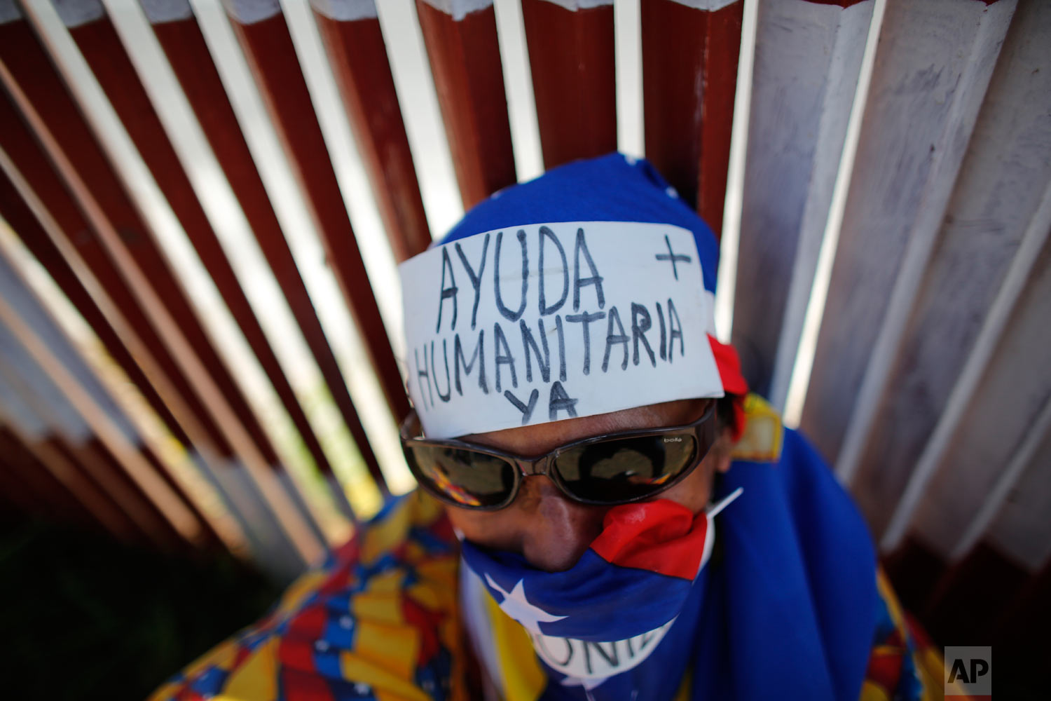 """An opposition protester wears the Spanish message on his forehead: """"Humanitarian aid now"""" during a demonstration urging soldiers to allow the entry of U.S. humanitarian aid in Caracas, Venezuela, Saturday, Feb. 23, 2019. (AP Photo/Ariana Cubillos)"""