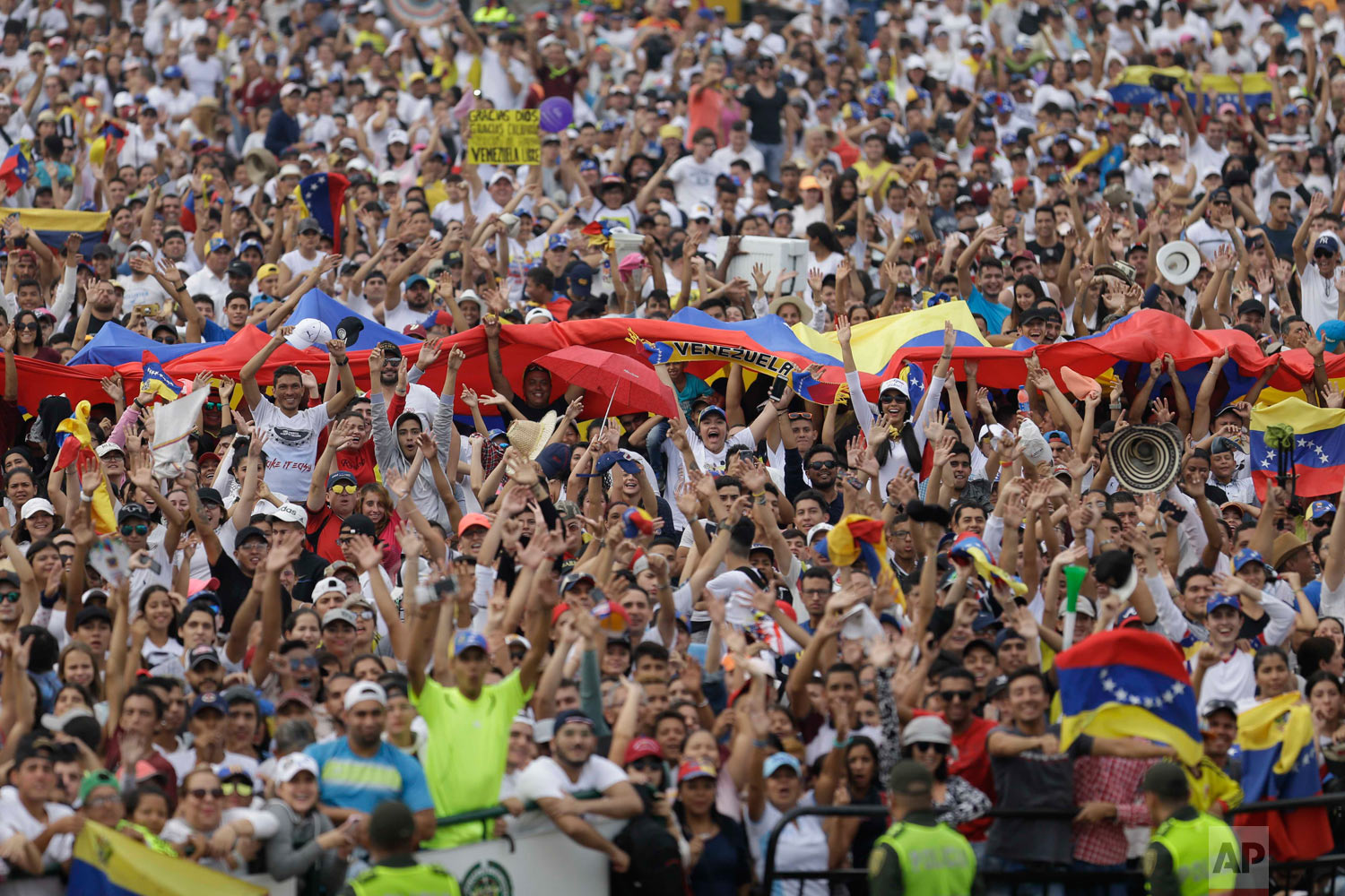 People begin to fill the Venezuela Aid Live concert on the Colombian side of the Tienditas International Bridge on the outskirts of Cucuta, Colombia, on the border with Venezuela, Friday, Feb. 22, 2019. (AP Photo/Fernando Vergara)