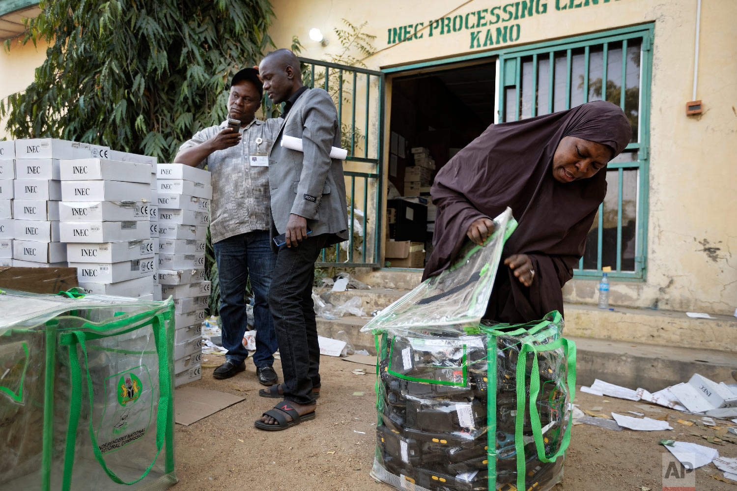 An electoral worker prepares identity card and biometric verification readers, at the offices of the Independent National Electoral Commission in Kano, northern Nigeria, Feb. 14, 2019. (AP Photo/Ben Curtis)