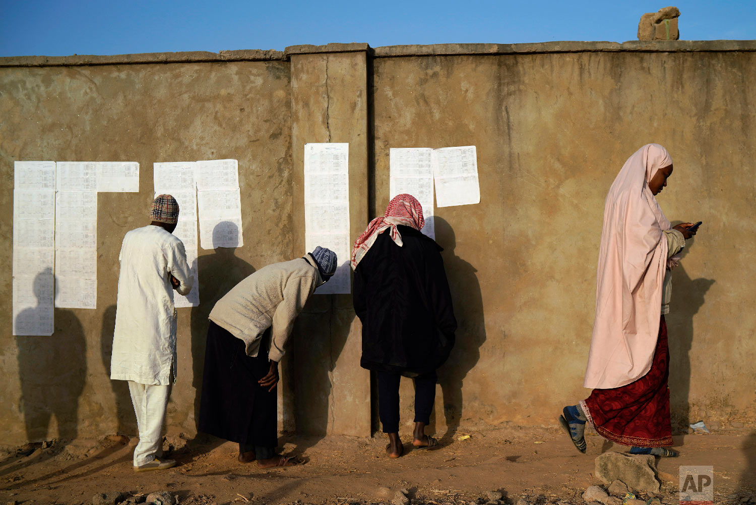 Nigerians check voters' lists at a polling station in Kaduna, Nigeria, Feb. 16, 2019. (AP Photo/Jerome Delay)