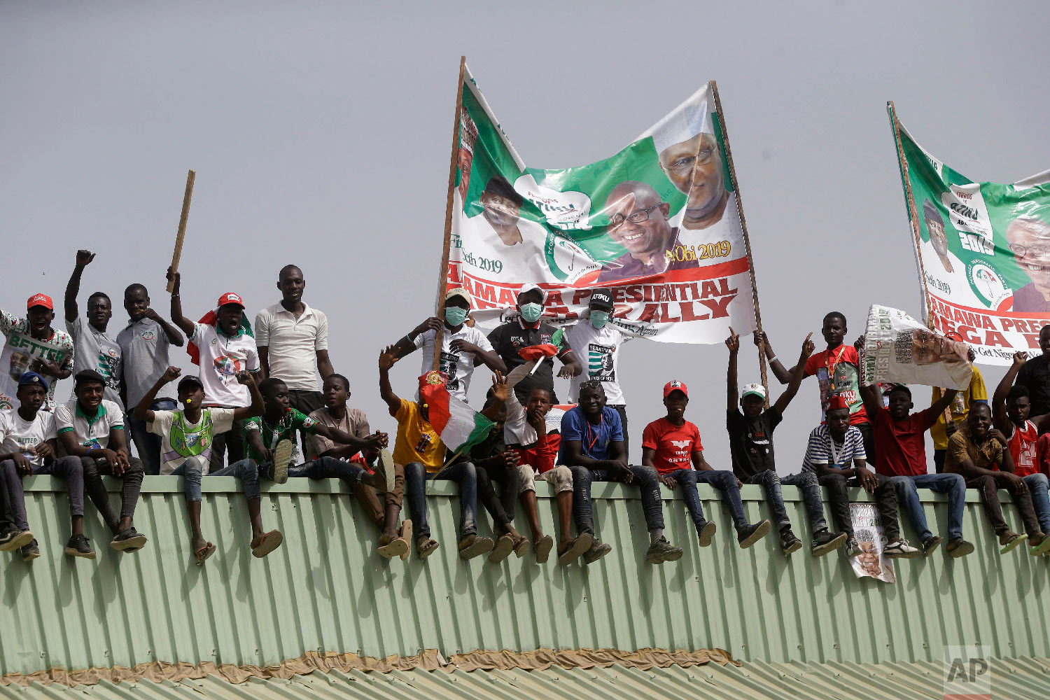 Supporters of Nigerian presidential candidate Atiku Abubakar, of the People's Democratic Party attend an election campaign rally on the street in Yola, Nigeria, Feb. 14, 2019. (AP Photo/Sunday Alamba)