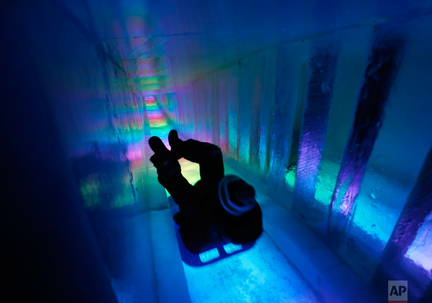 A man zooms down a 97-foot ice slide at Ice Castles in North Woodstock, N.H., on Jan. 26, 2019. (AP Photo/Robert F. Bukaty)