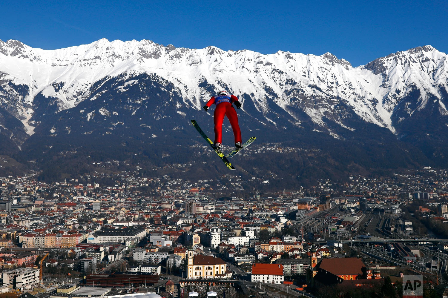 Russia's Viachelslav Barkov soars through the air during the Nordic Combined, Ski Jumping Team Sprint HS130 event, at the Nordic Ski World Championships in Innsbruck, Austria, Sunday, Feb. 24, 2019. (AP Photo/Matthias Schrader)