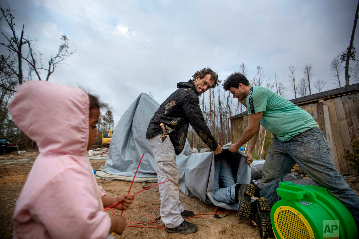 "Jeff Dunn, left, and Lance Gomez help construct a dome shelter in Diahn ""Shelly"" Summers' backyard for local residents left homeless from Hurricane Michael in Youngstown, Fla, Wednesday, Jan. 23, 2019. (AP Photo/David Goldman)"