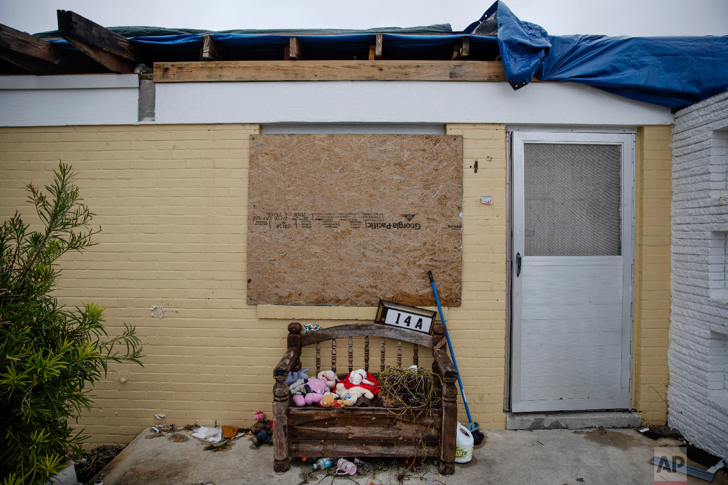 Stuffed animals sit outside a boarded up housing development damaged from Hurricane Michael in Panama City, Fla, Thursday, Jan. 24, 2019. (AP Photo/David Goldman)