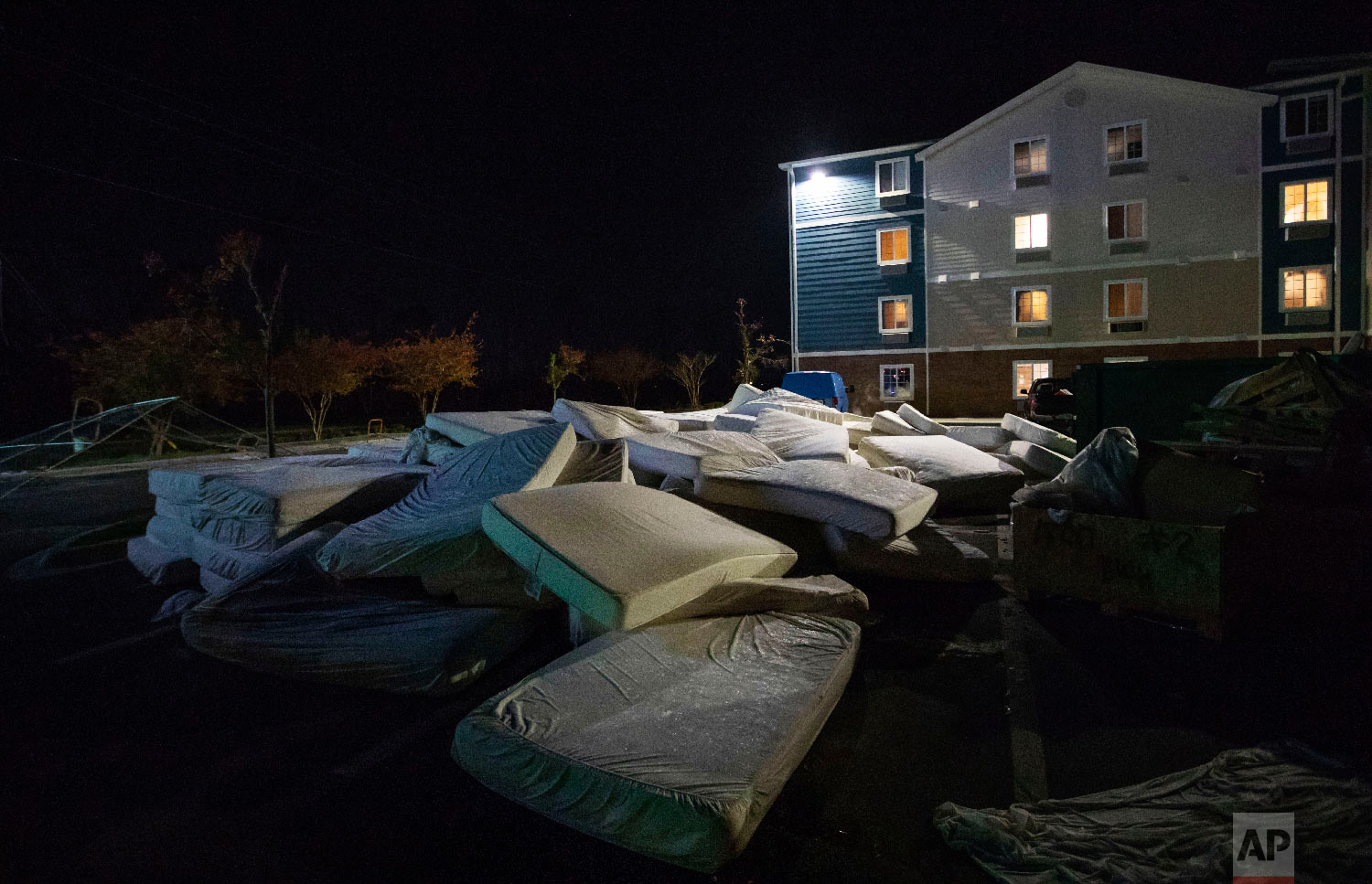 Mattresses are discarded from a damaged hotel from Hurricane Michael which is closed during renovation in Panama City, Fla, Thursday, Jan. 24, 2019. (AP Photo/David Goldman)