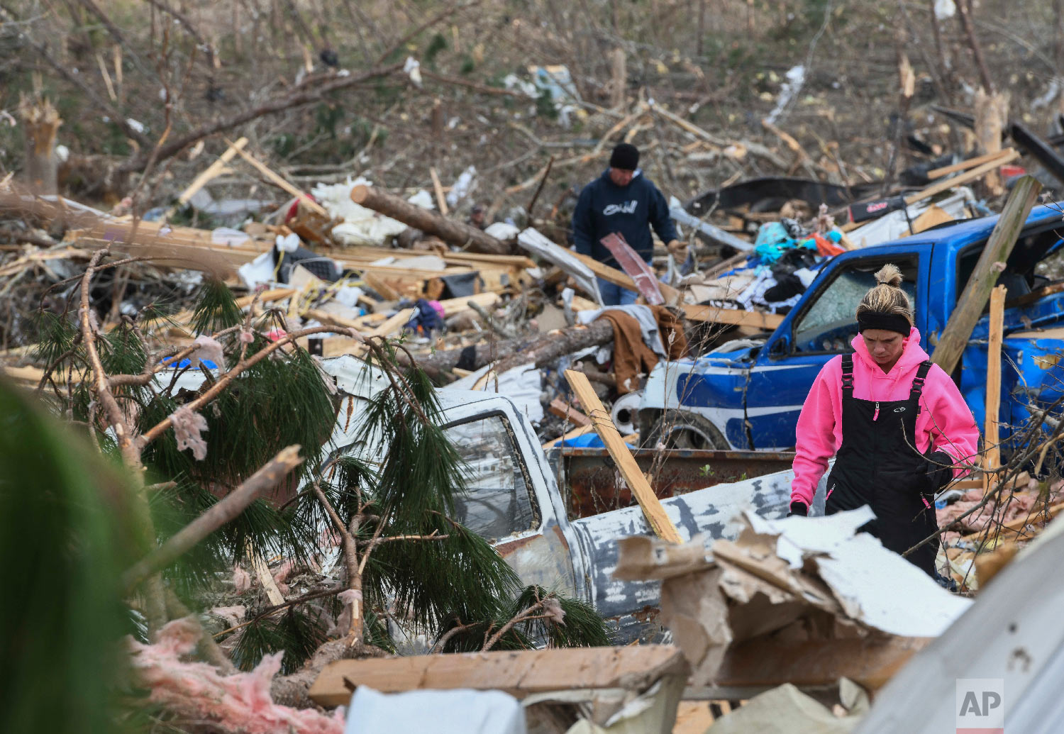Residents and family members sift through the debris of their homes near Lee County Road 38 in Beauregard, Ala., March 4, 2019, a day after tornados ravaged the area. (AP Photo/Julie Bennett)