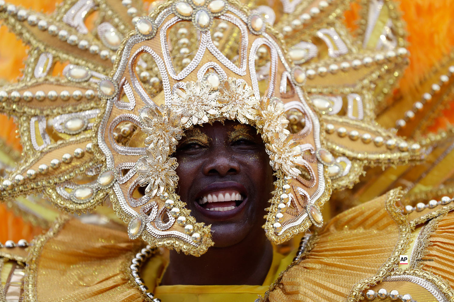 A dancer from the Tom Maior samba school performs during a carnival parade in Sao Paulo, Brazil, Saturday, March 2, 2019. (AP Photo/Andre Penner)