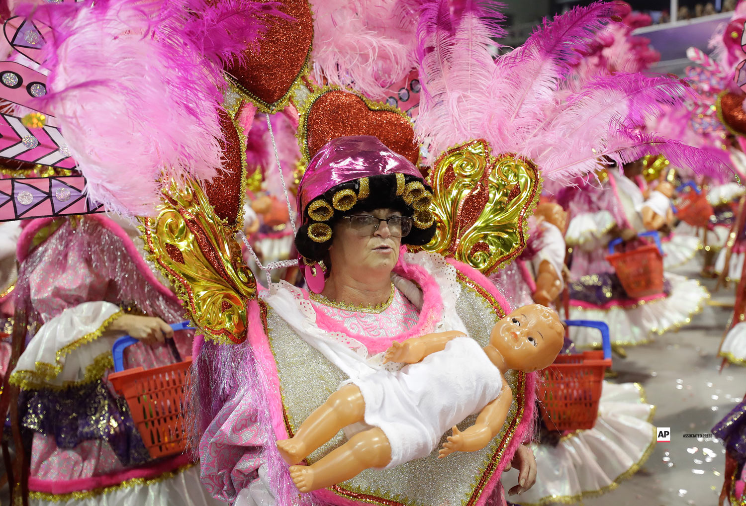 A dancer from the Academicos do Tatuape samba school performs during a carnival parade in Sao Paulo, Brazil, Saturday, March 2, 2019. (AP Photo/Andre Penner)