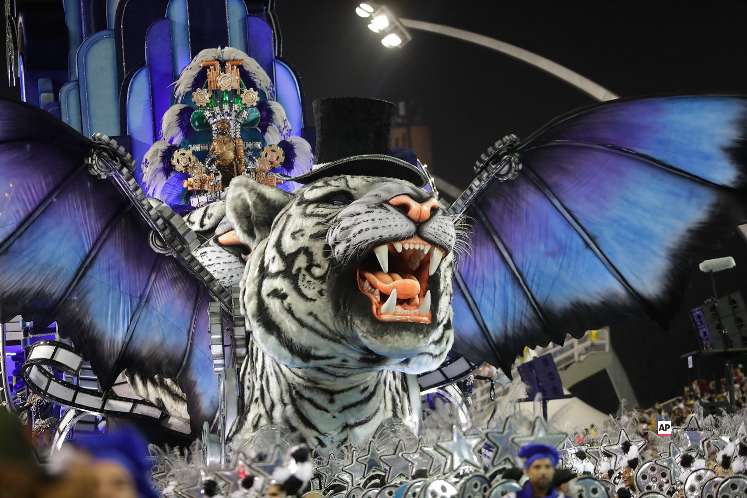 Dancers from the Imperio de Casa Verde samba school perform on a float during a carnival parade in Sao Paulo, Brazil, Saturday, March 2, 2019. (AP Photo/Andre Penner)