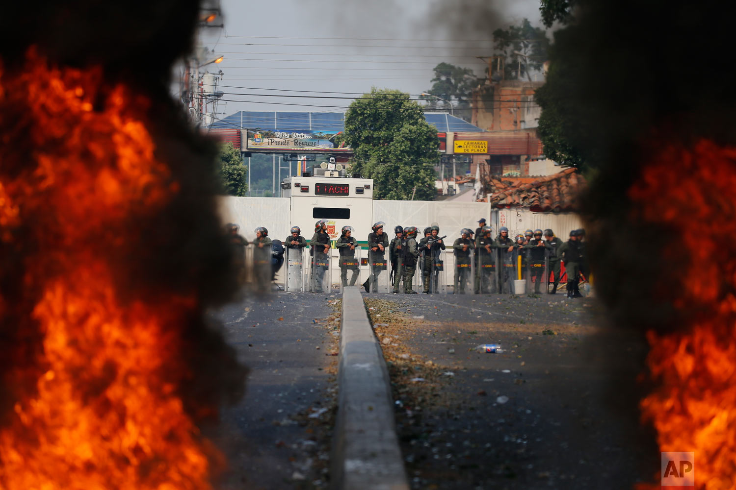 Bolivarian National Guard troops man a barricade blocking access to the Francisco De Paula Santander international bridge in Urena, Venezuela, on the border with Colombia, Feb. 23, 2019. (AP Photo/Fernando Llano)