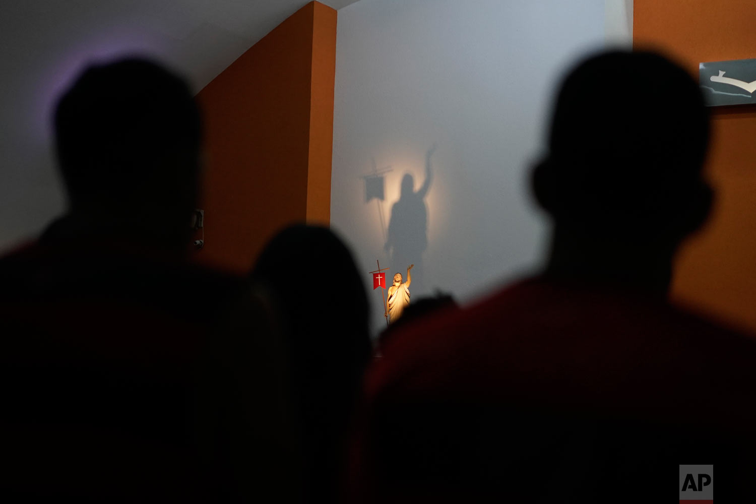 People attend a memorial Mass for the 10 teenage victims of a fire at a Brazilian soccer academy, in Rio de Janeiro, Brazil, Feb. 8, 2019. (AP Photo/Leo Correa)
