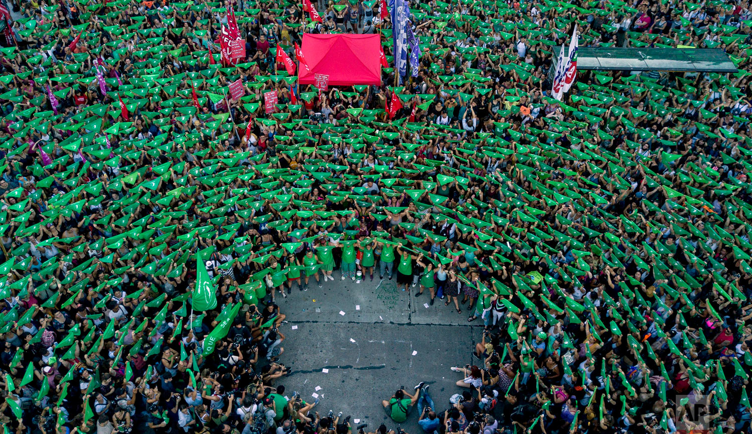 Pro-choice activists in favor of decriminalizing abortion raise green handkerchiefs as they rally outside Congress in Buenos Aires, Argentina, Feb. 19, 2019. (AP Photo/Tomas F. Cuesta)