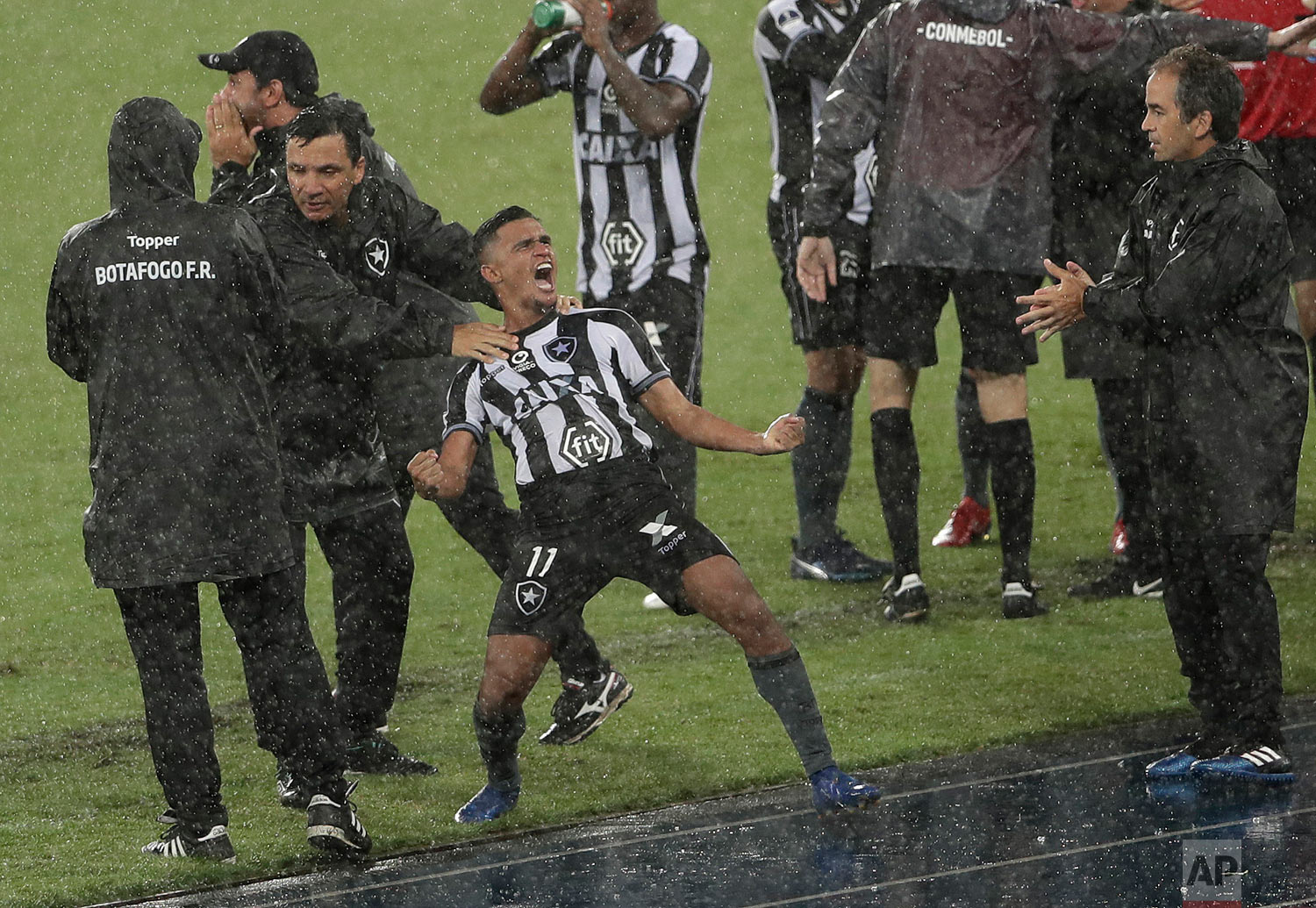 Erik of Brazil's Botafogo celebrates scoring his side's first goal during a Copa Sudamericana soccer match against Argentina's Defensa y Justicia, in Rio de Janeiro, Brazil, on a rainy Feb. 6, 2019. (AP Photo/Silvia Izquierdo)