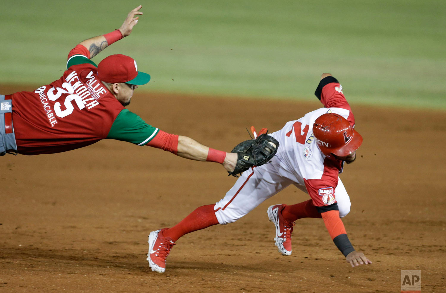 Victor Mendoza of Mexico's Los Charros de Jalisco tags out Alexi Amarista of Venezuela's Cardenales de Lara, on the opening day of the Caribbean Series baseball tournament at Rod Carew stadium in Panama City, Feb. 4, 2019. (AP Photo/Arnulfo Franco)
