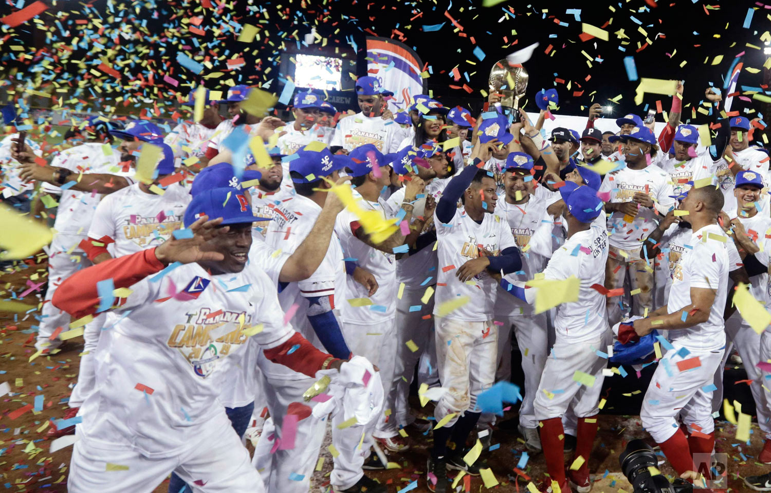 Panama's Los Toros de Herrera baseball players celebrate their 3-0 victory over Cuba's Los Leneros de las Tunas amid confetti at the end of the Caribbean Series baseball tournament's final, championship game at Rod Carew stadium in Panama City, Feb. 10, 2019. (AP Photo/Arnulfo Franco)