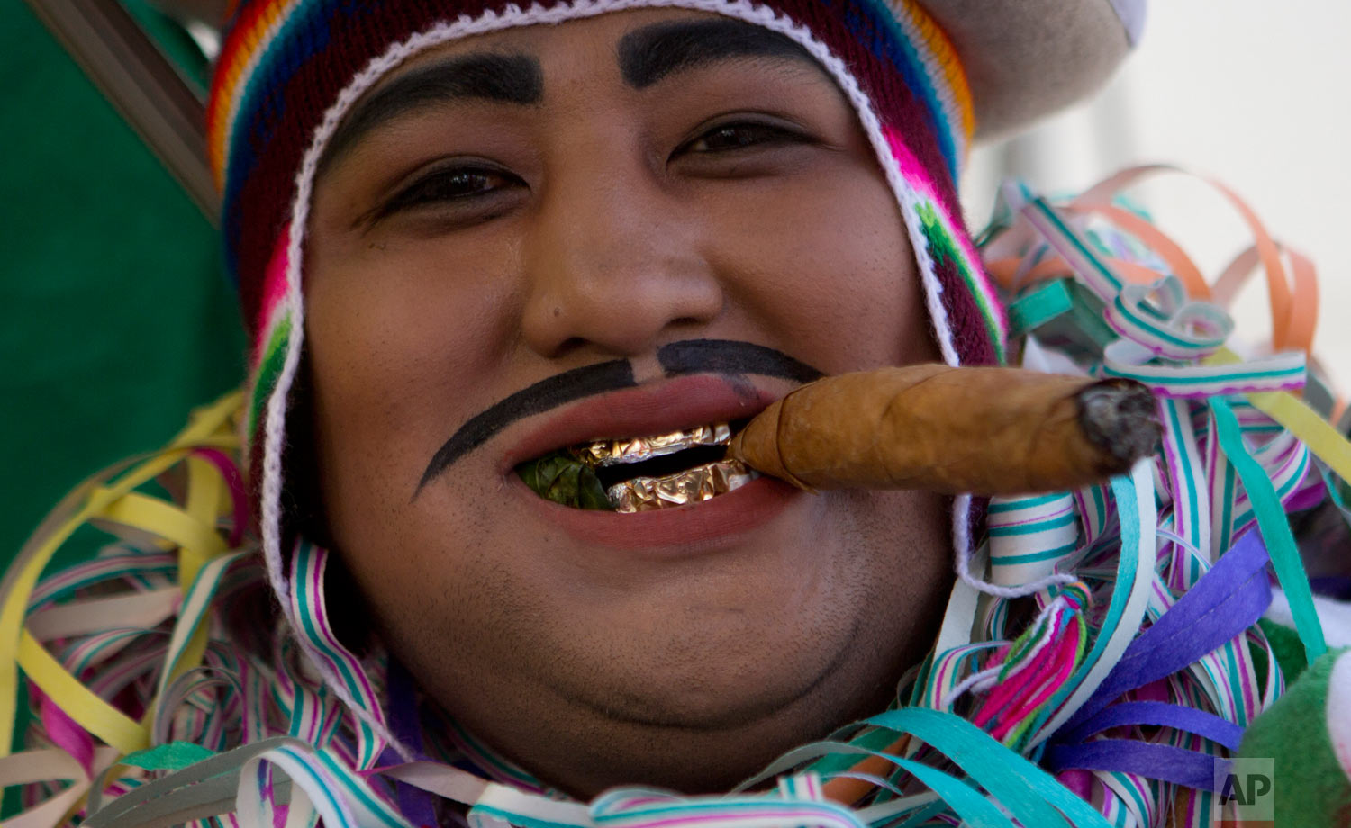 "A man dressed as ""Ekeko"" competes in a costume contest during the Alasita miniature fair in La Paz, Bolivia, Feb. 5, 2019. (AP Photo/Juan Karita)"