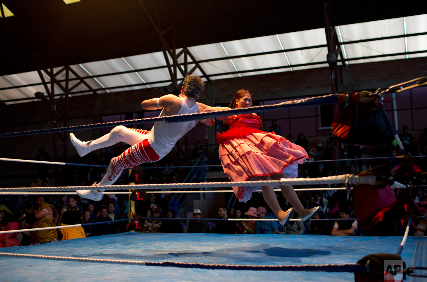 Veteran cholita wrestler Jennifer Dos Caras, 45, competes in the ring with Randy Four in El Alto, Bolivia, Jan. 21, 2019. (AP Photo/Juan Karita)