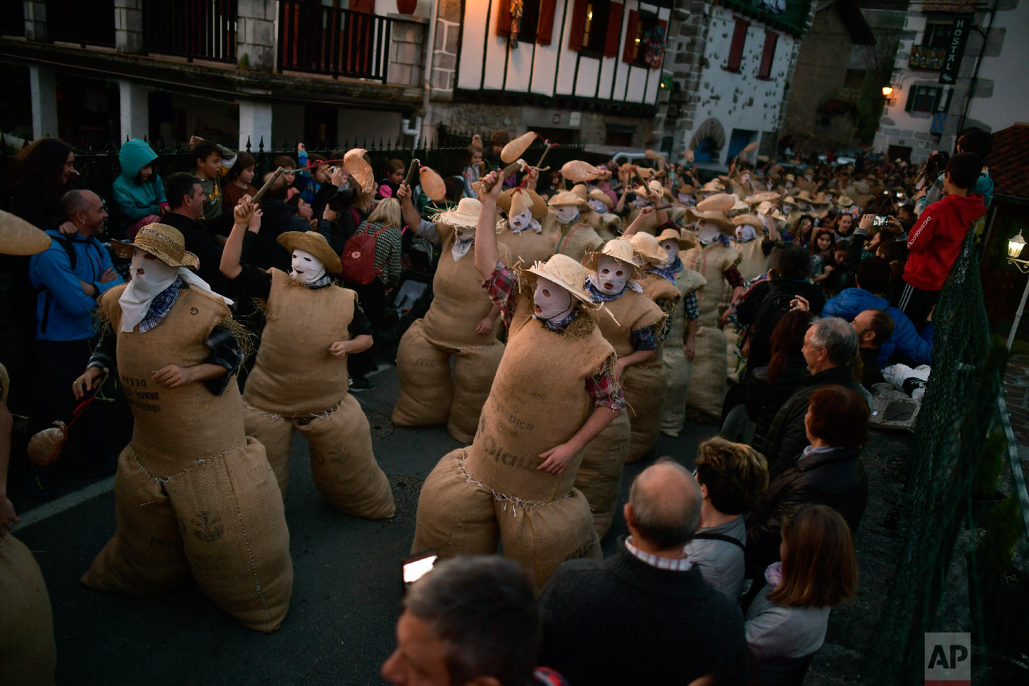 "People dressed as the traditional carnival characters ""Zaku Zaharrak,"" or old sack, in Basque language, take part during carnival parade in the small Pyrenean village of Lesaka, northern Spain, Sunday, March 3, 2019. (AP Photo/Alvaro Barrientos)"
