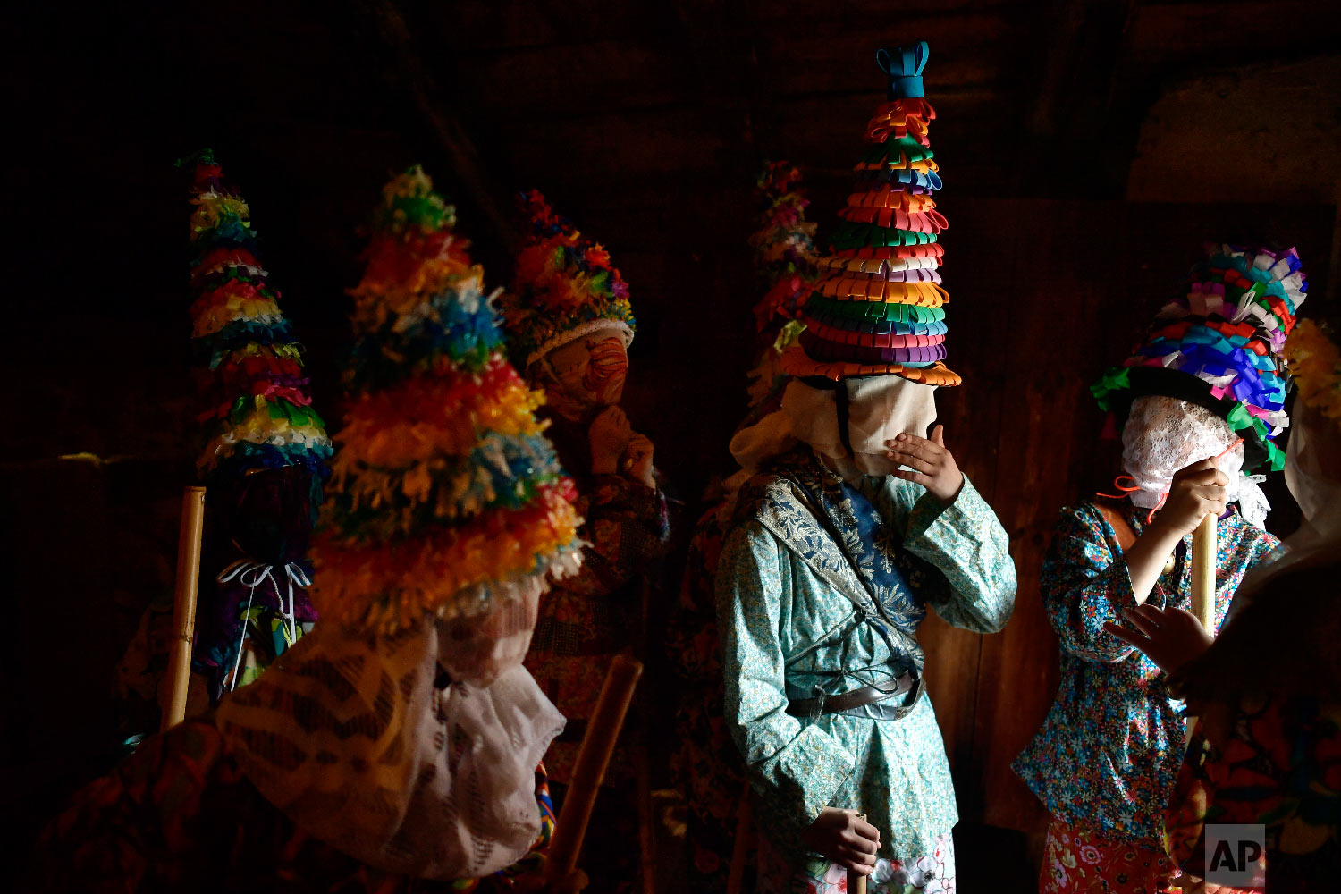People prepare to takes part in ancient rural carnival in the small Pyrenees village of Lantz, northern Spain, Sunday, March 3, 2019. The carnival is a long-standing rural tradition in which the forces of good and evil confront each other in a symbolic battle. (AP Photo/Alvaro Barrientos)