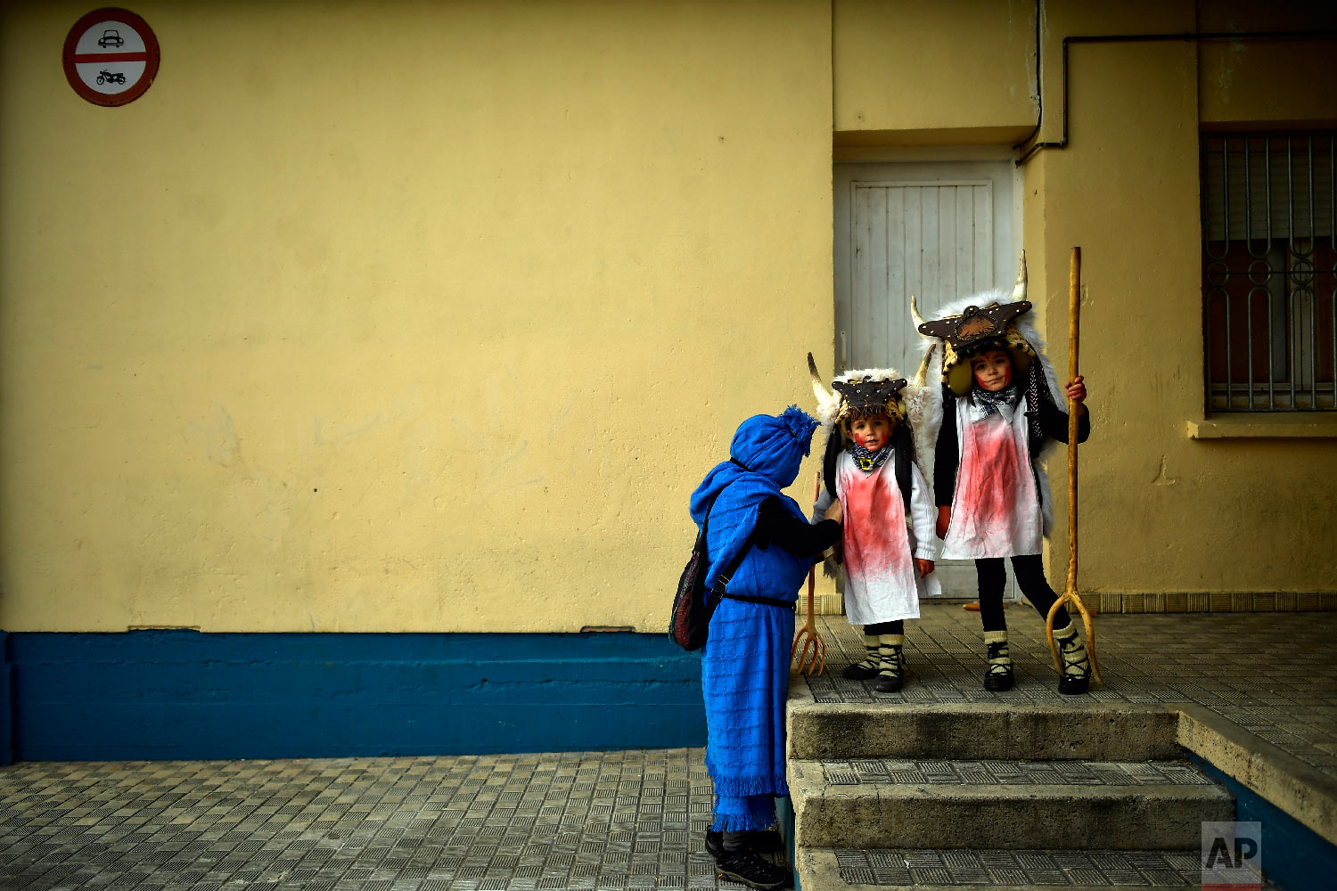 "Young ""Momotxorros "" prepare to take part in the carnival wearing typical carnival dress, in Alsasua, northern Spain, Tuesday, March 5, 2019. (AP Photo/Alvaro Barrientos)"