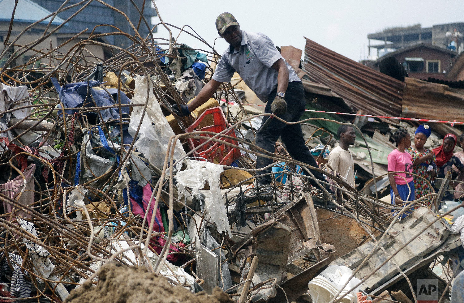 Government officials from Standard Organisation of Nigeria examine materials used in constructing the building that collapsed in Lagos, Nigeria, Thursday, March 14, 2019. (AP Photo/Sunday Alamba)