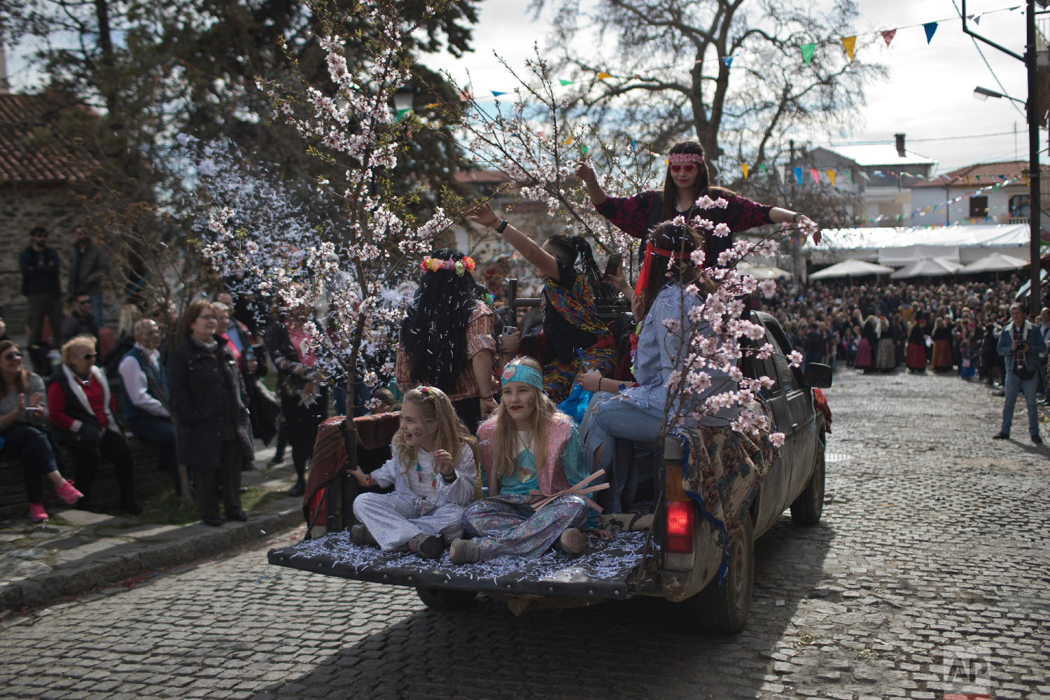 Participants in the Clean Monday festival ride in a pick-up truck at the village of Sohos, northern Greece on March 11, 2019. (AP Photo/Petros Giannakouris)