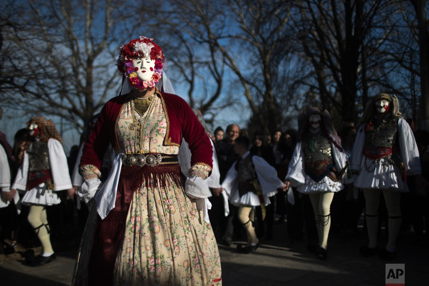 Dancers with masks and traditional costume perform in the Boules and Genitsaroi carnival parade in the town of Naousa, northern Greece on March 10, 2019. (AP Photo/Petros Giannakouris)